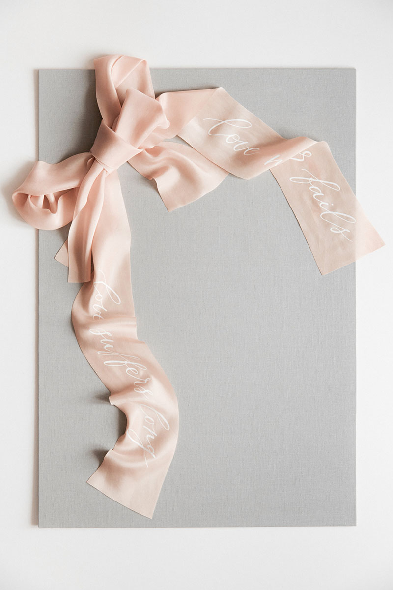 Bark-and-Berry-Cloud-Linen-styling-boards-for-wedding-stationery-bouquet-detail-flatlay-shot-blush-plant-dyed-bias-cut-calligraphy-silk-ribbons-002